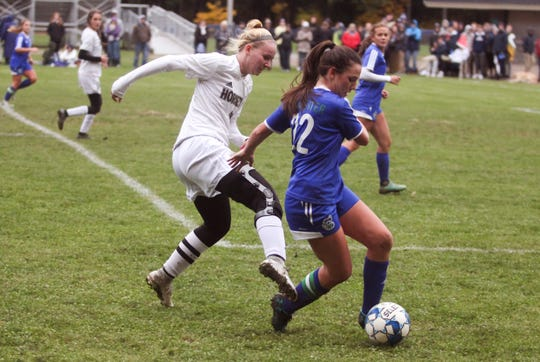 Colchester's Summer Hathaway and Essex's Aidan Briley fight for a loose ball during Wednesday's Division I girls soccer semifinal in Colchester.