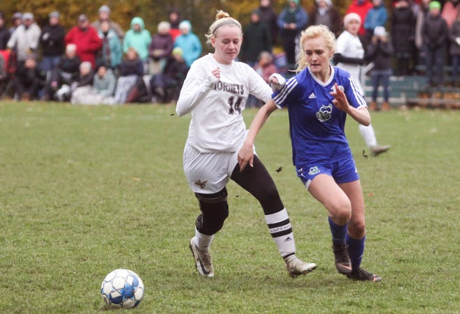 Colchester's Brooke Booska, right, and Aidan Briley of Essex chase down a loose ball during Wednesday's Division I girls soccer semifinal in Colchester