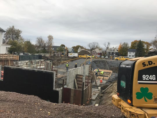 Crews from S.D. Ireland work on the lower story of the new Greater Burlington YMCA building on College Street on Wednesday, Oct. 31, 2018.