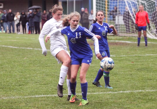 Essex's Abigail Couture tries to win the ball away from Colchester's Jessica Laquerre during Wednesday's Division I girls soccer semifinal in Colchester.