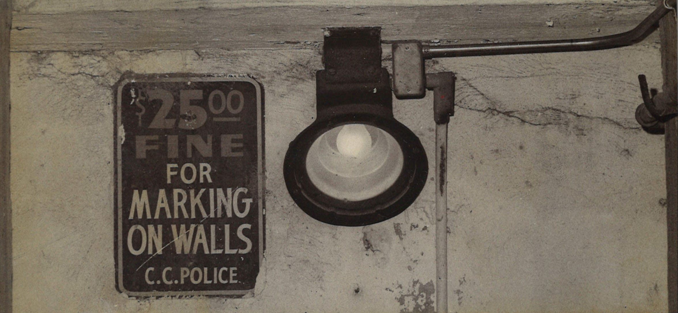 A sign inside the bluff tunnel between uptown and downtown Corpus Christi from January 1975.