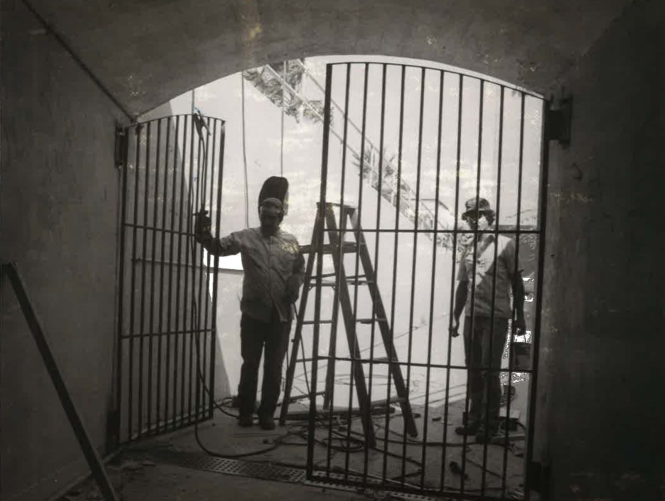 Workers seal of the bluff pedestrian tunnel between uptown and downtown Corpus Christi in September 1977.