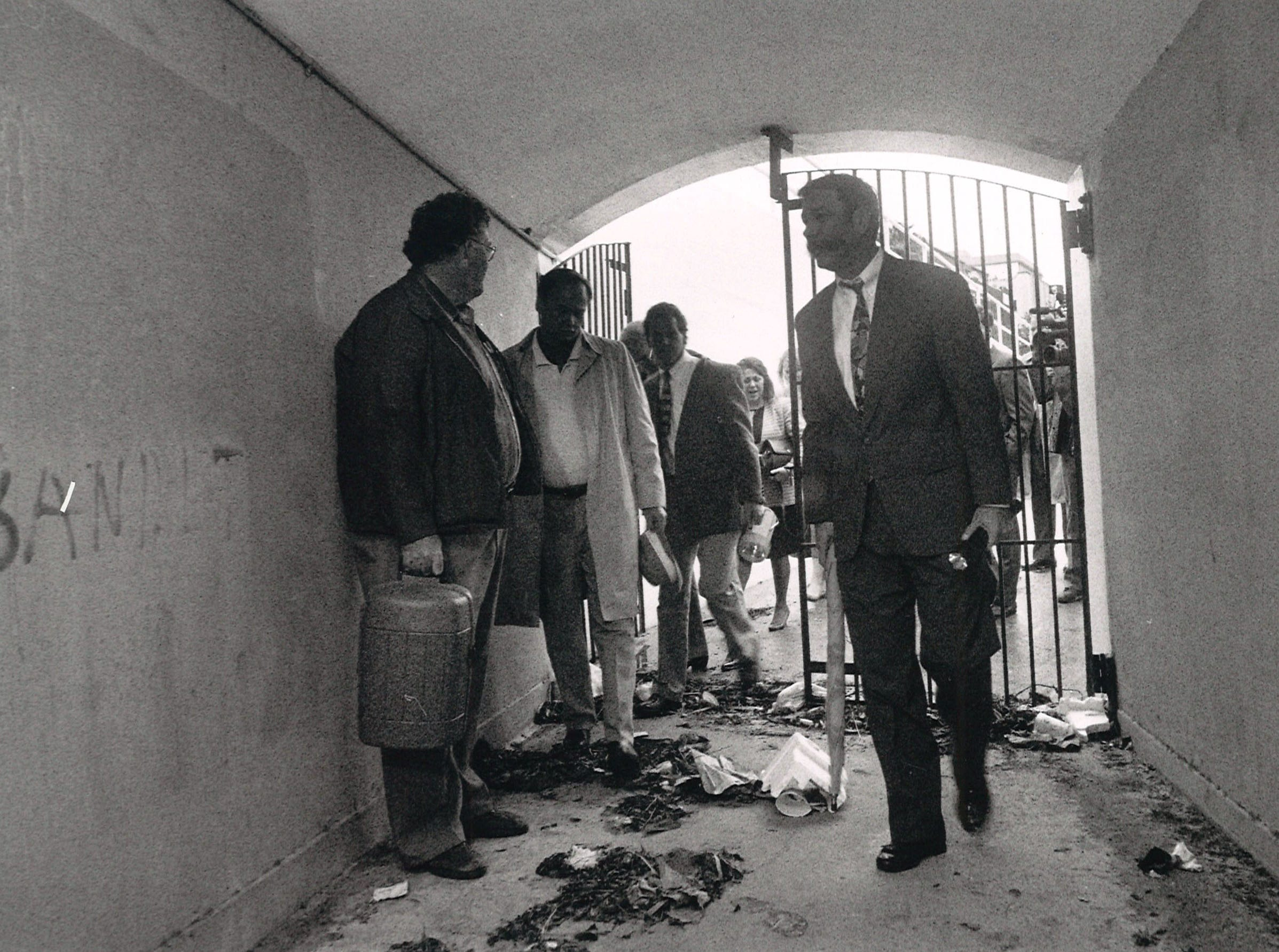 Heart of Corpus Christi president Kevin Walker (right) along with members of the organization's Public Space Management Committee and building managers from the Wilson Building, First City Tower and the 600 Building enter the bluff tunnel for a tour in April 1991 to determine the measures needed to reopen the tunnel.