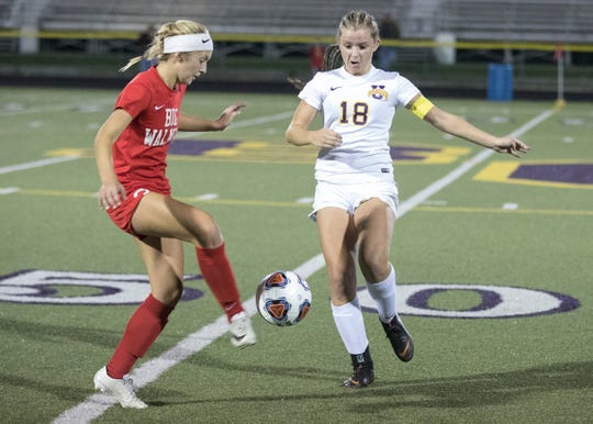 Unioto's Jayla Campbell and a player from Big Walnut battle over possession of the ball during the Division II soccer regional semifinals game Tuesday night at Bloom-Carroll High School.