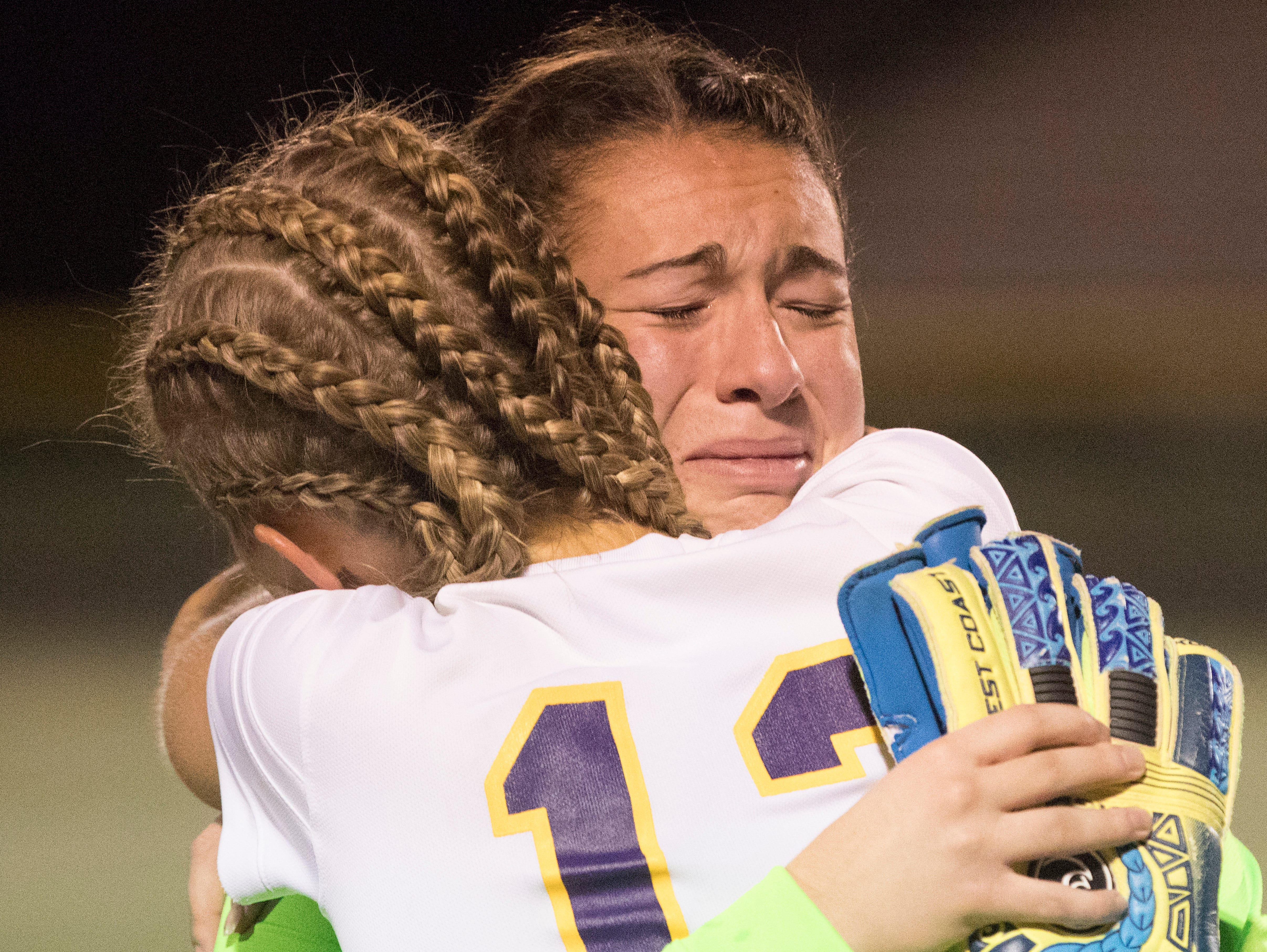 Goalkeeper Sydney Free and senior Elayna Gunnoe embrace after their loss against Big Walnut Tuesday night in a Division II soccer regional semifinals match.