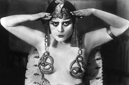 "Actress Theda Bara caused a stir with her revealing outfits in ""Cleopatra"" (1917)."
