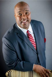 Michael Johnson, CEO of the United Way of Greater Cincinnati, will rely on his experience as a bridge-builder to make a difference in the city.