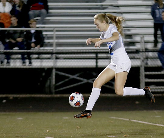 Summit Country Day midfielder/forward Colleen McIlvenna floats the ball upfield against Indian Hill during their Division II girls regional soccer tournament game at Jim VanDeGrift Stadium in Lebanon Tuesday, Oct. 30, 2018.