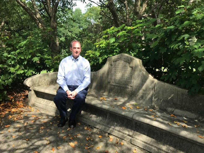 Rudy Siegel, member of Ault Park Advisory Council, sits on the World War I memorial bench Aug. 31, 2018. It was constructed in 1920 by the Garden Club of Cincinnati in honor of Cincinnati citizens who gave their lives in the country's service 1917-1918.  The bench is just off Principio Avenue.