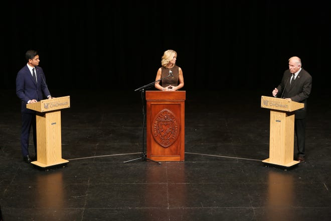 Aftab Pureval and Rep. Steve Chabot answer questions posed by a panel and moderator Tricia Macke of Fox19, during their final debate Tuesday, just one week before Election Day. The Enquirer hosted the debate in conjunction with Fox 19, the University of Cincinnati, the Cincinnati USA Regional and African American chambers of commerce between candidates vying to represent Ohio's 1st Congressional District.The debate was held at 7 p.m. Tuesday, Oct. 30, in the University of Cincinnati's Patricia Corbett Theatre.
