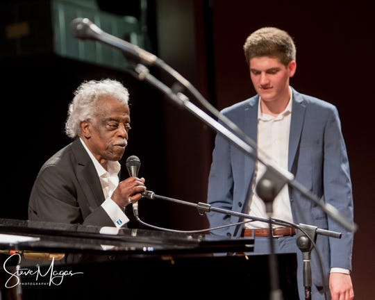During the past year, legendary King Records session drummer Phillip Paul, left, has struck up a close musical comradeship with 19-year-old pianist Ben Levin. They are seen here during a Freedom Center performance they shared in June. Their work together will be featured on Levin's upcoming CD. They will also perform together as part of a Jan. 11 concert to benefit King Records.