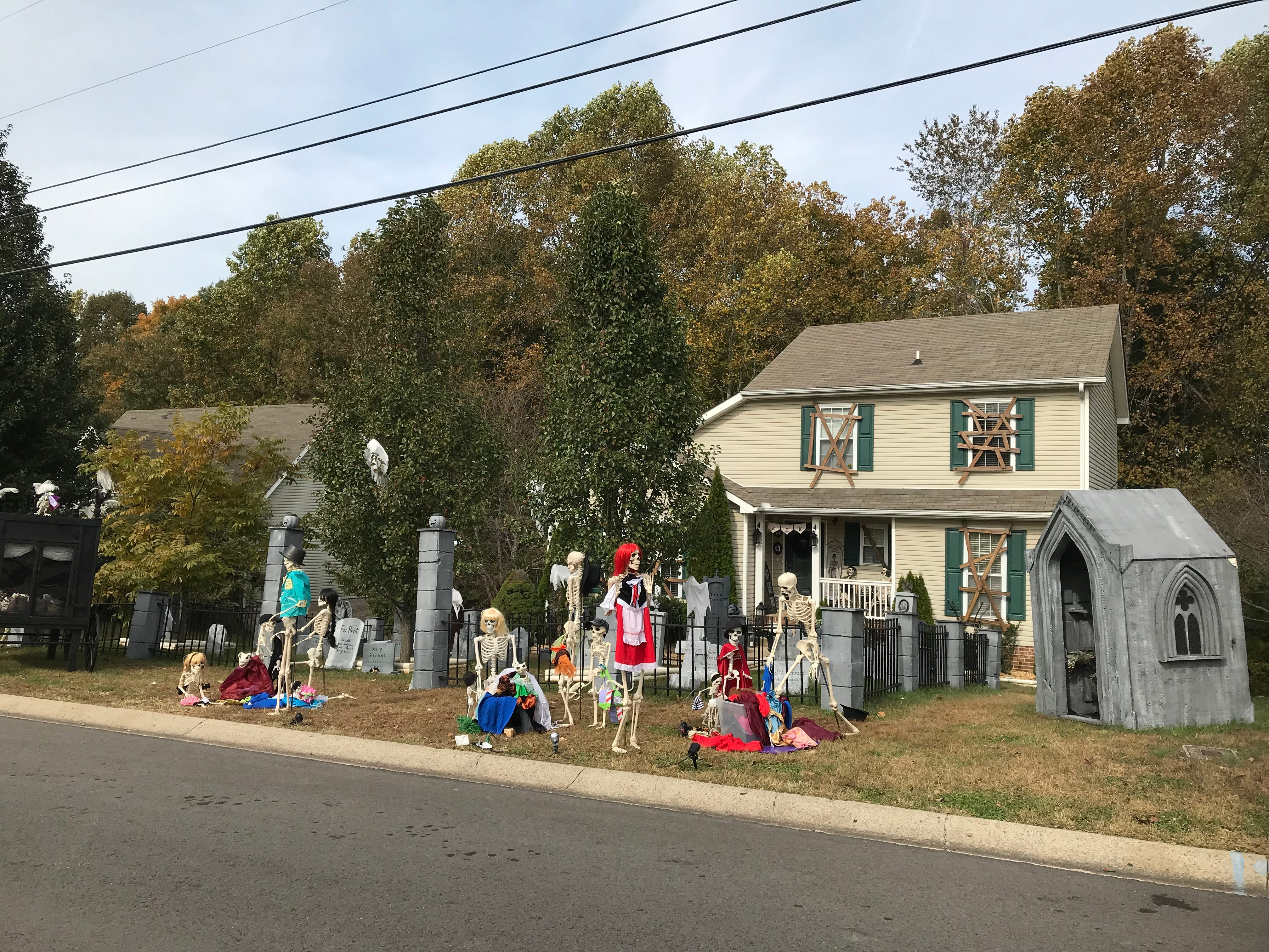The Garcia's Clarksville home features a family of skeletons, bony pets, graveyard and mausoleum and the scene changes every night from Oct. 1 to Nov. 1.