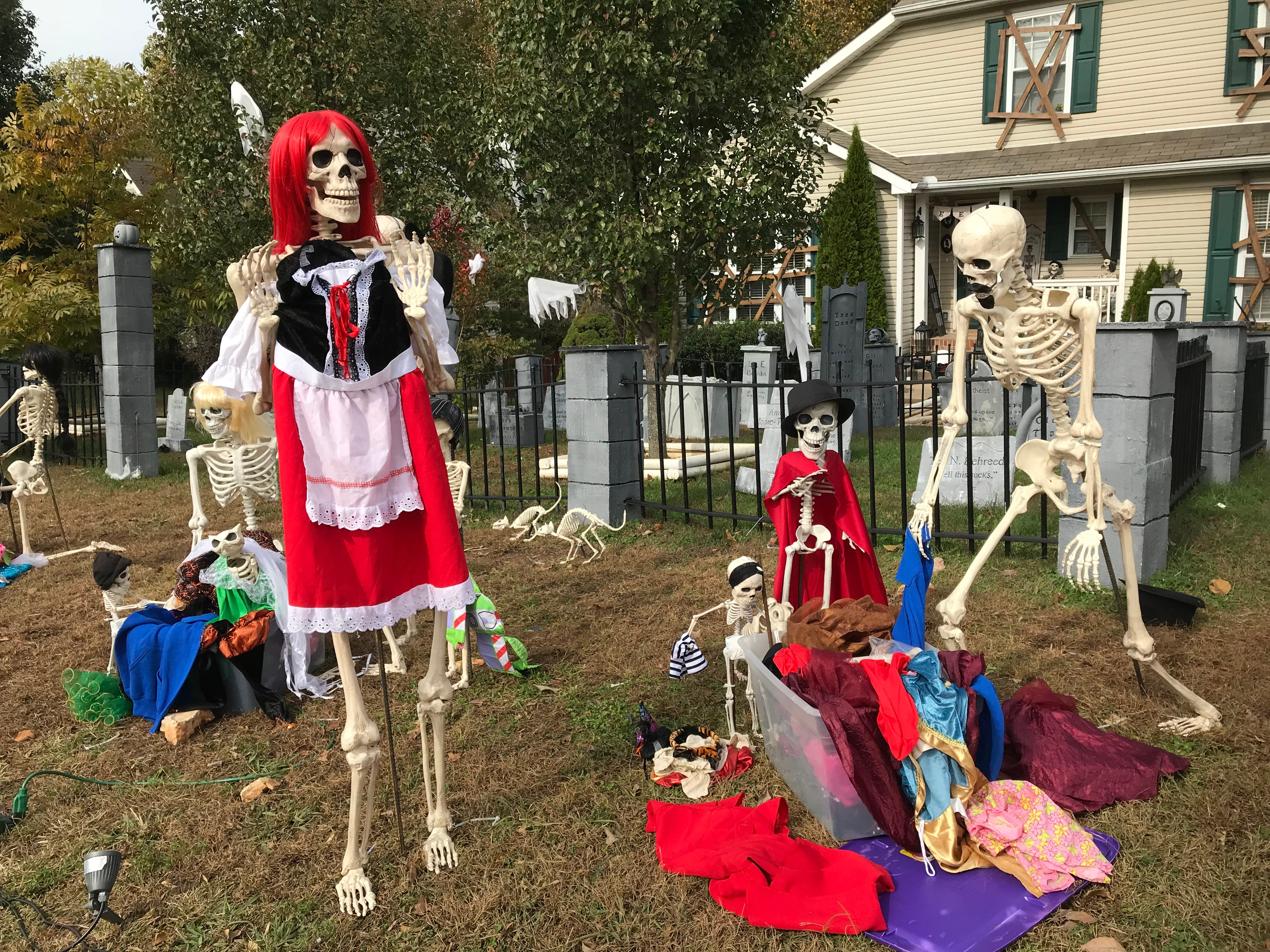 The Garcias' Clarksville home features a family of skeletons, bony pets, graveyard and mausoleum and the scene changes every night from Oct. 1 to Nov. 1.
