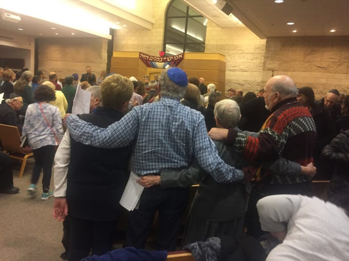 Nearly 1,000 people gathered at Temple Beth-El in Hillsborough Tuesday night for an Interfaith Vigil in Solidarity with the Jewish Community of Pittsburgh. The vigil included speakers from seven different faiths, state and government representatives, songs and prayers for healing and hope. The Stand Up for the Other Pledge also was part of the evening.
