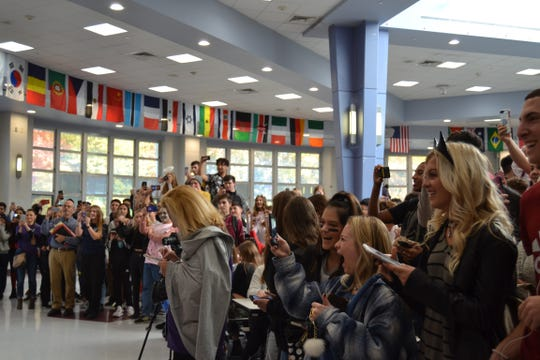 "Spectators look on as Old Bridge High School staff perform flash mob to ""Thriller"" during lunch period."