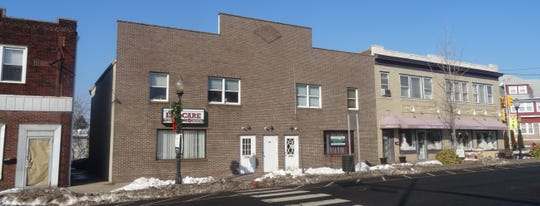 The other building in this sale,206 S. Main St., Manville, is almost identical.