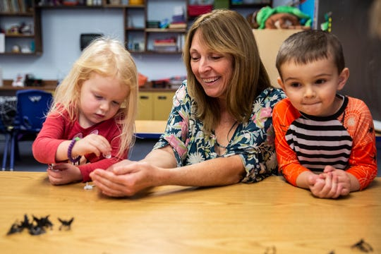 Michelle Brooke, owner and director of Curious Kids Childcare, works on counting with Curious Kids student Mia Morgan on Wednesday, Oct. 31, 2018, in Centerville.