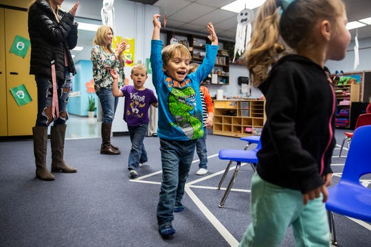 Parker Schmell and his classmates at Curious Kids Childcare play a Halloween themed version of musical chairs on Wednesday, Oct. 31, 2018, in Centerville.