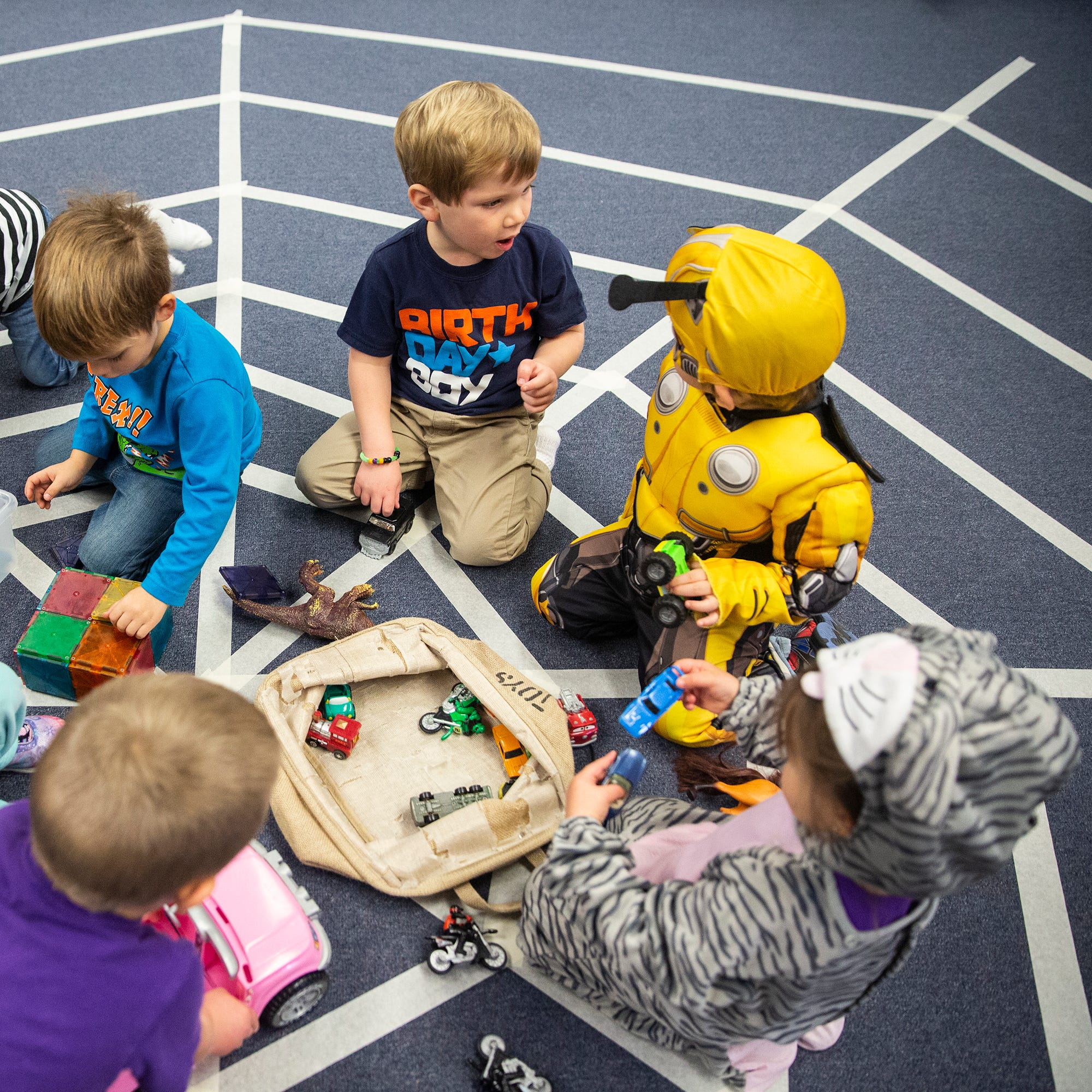 A group of students at Curious Kids Childcare play with toys on Wednesday, Oct. 31, 2018, in Centerville.