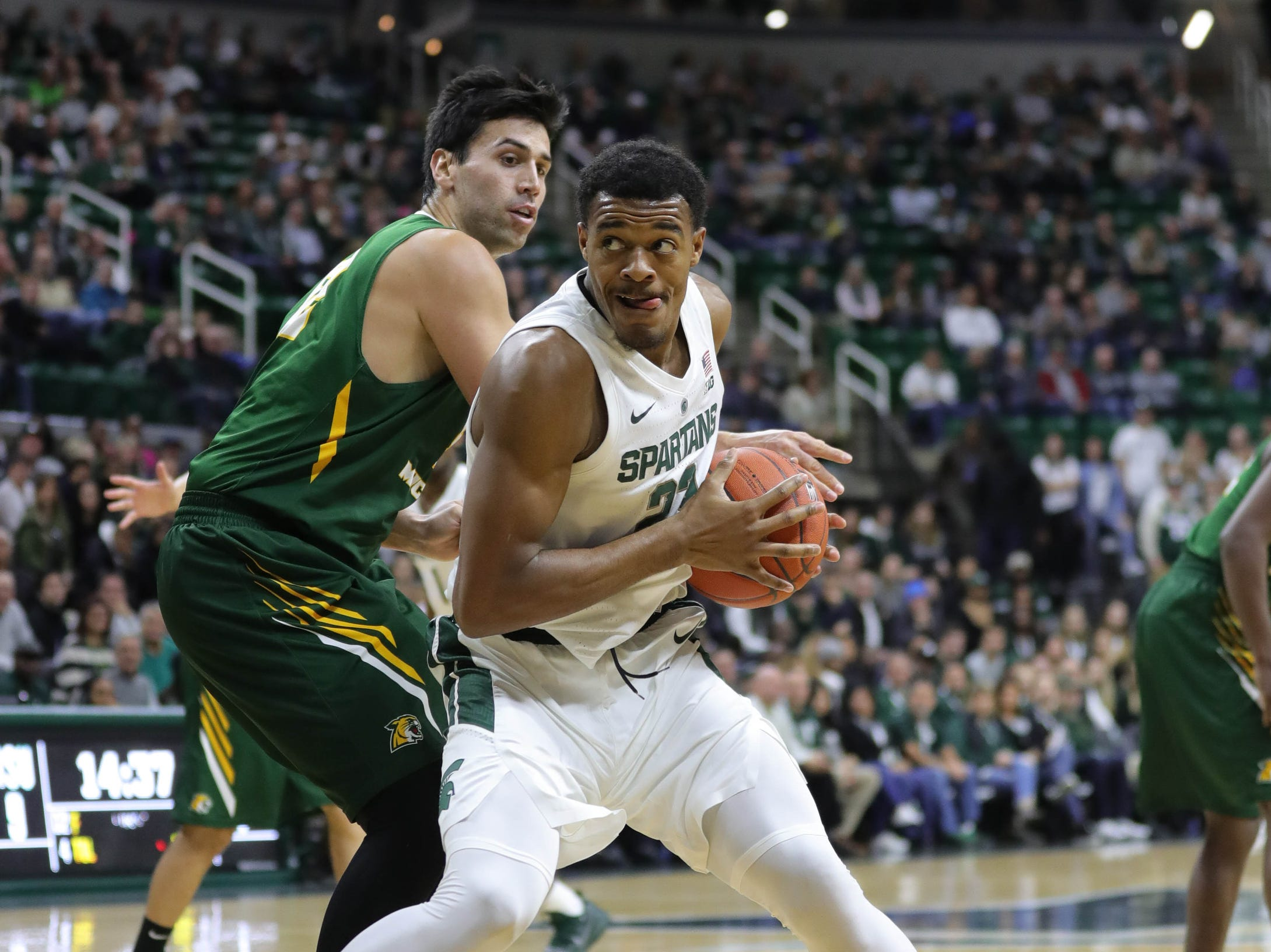 Michigan State forward Xavier Tillman drives Max Pendergast against Northern Michigan during first half action Tuesday, October 30, 2018 at the Breslin Center in East Lansing, Mich.