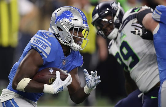 Detroit Lions' Kerryon Johnson looks for yardage against the Seattle Seahawks during the second quarter at Ford Field on Oct. 28, 2018 in Detroit.
