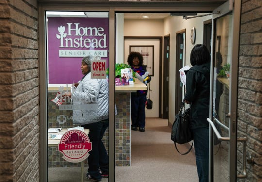 Caregivers talk with staff at Home Instead Senior Care in Birmingham on Tuesday, Oct. 16, 2018, following a training session.