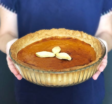 Woman Offering Pumpkin Pie