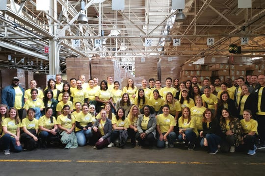 Ernst & Young employees pose for a photo during Connect Day.