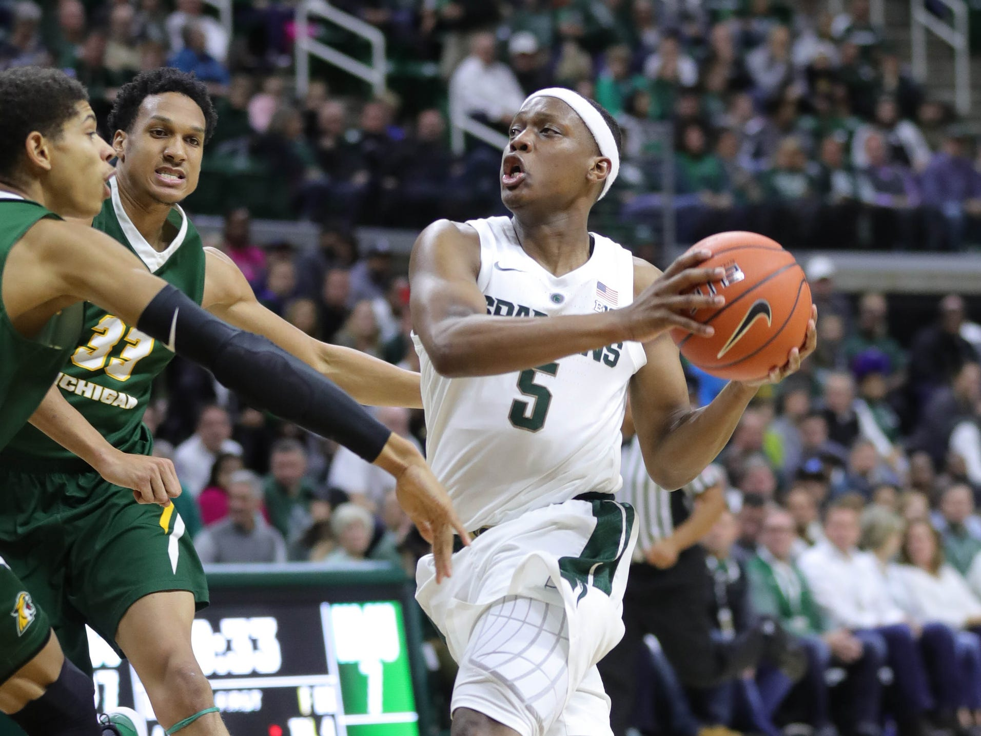 Michigan State guard Cassius Winston scores against Northern Michigan during first half action Tuesday, October 30, 2018 at the Breslin Center in East Lansing, Mich.