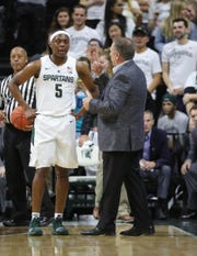 Michigan State head coach Tom Izzo talks with Cassius Winston during first half action against Northern Michigan Tuesday, October 30, 2018 at the Breslin Center in East Lansing, Mich.