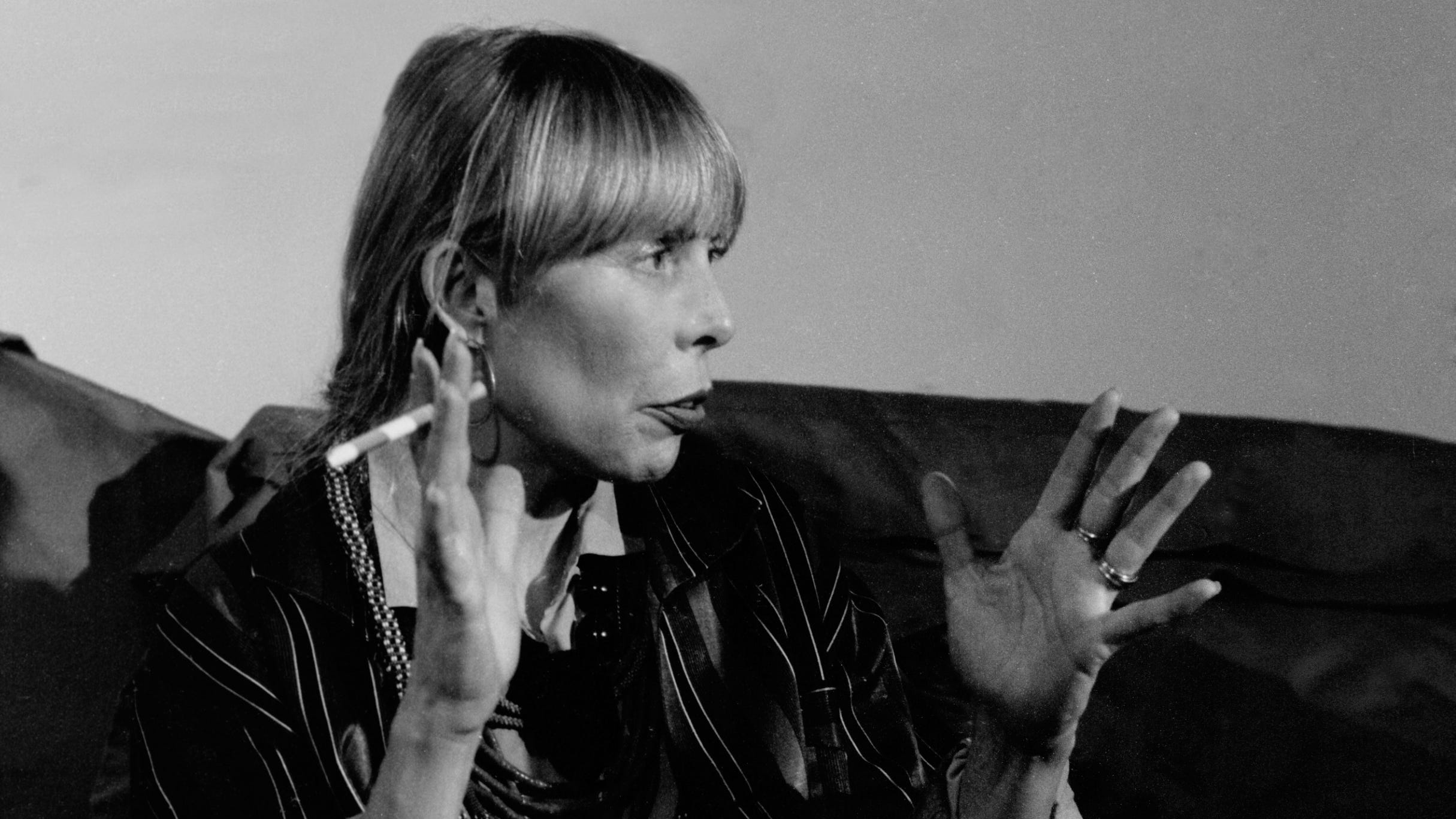 Joni Mitchell in 1988, with trademark cigarette in hand.