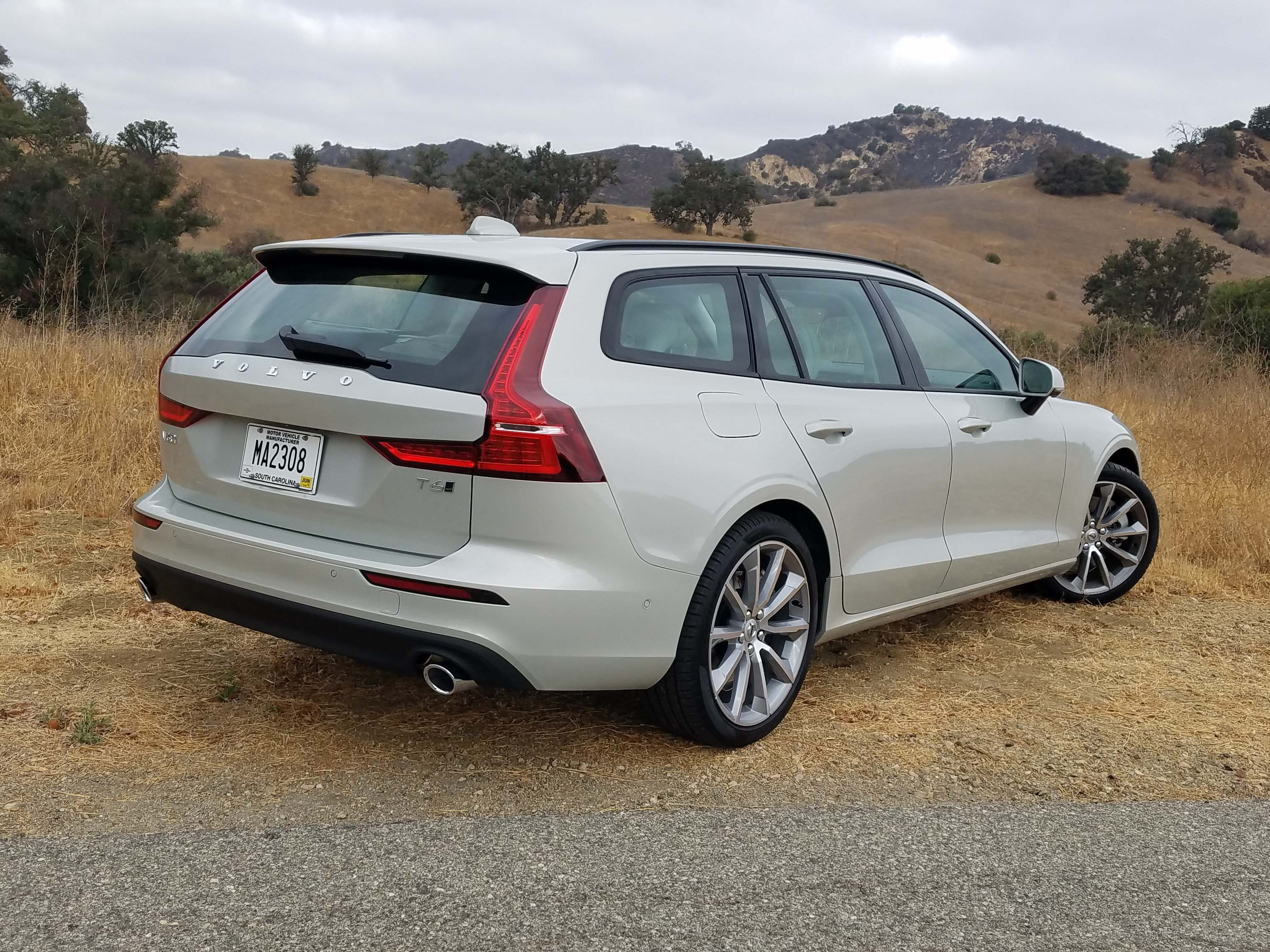 You'll know it by the big, rear, bat-wing taillights: The 2019 Volvo V60 wagon.