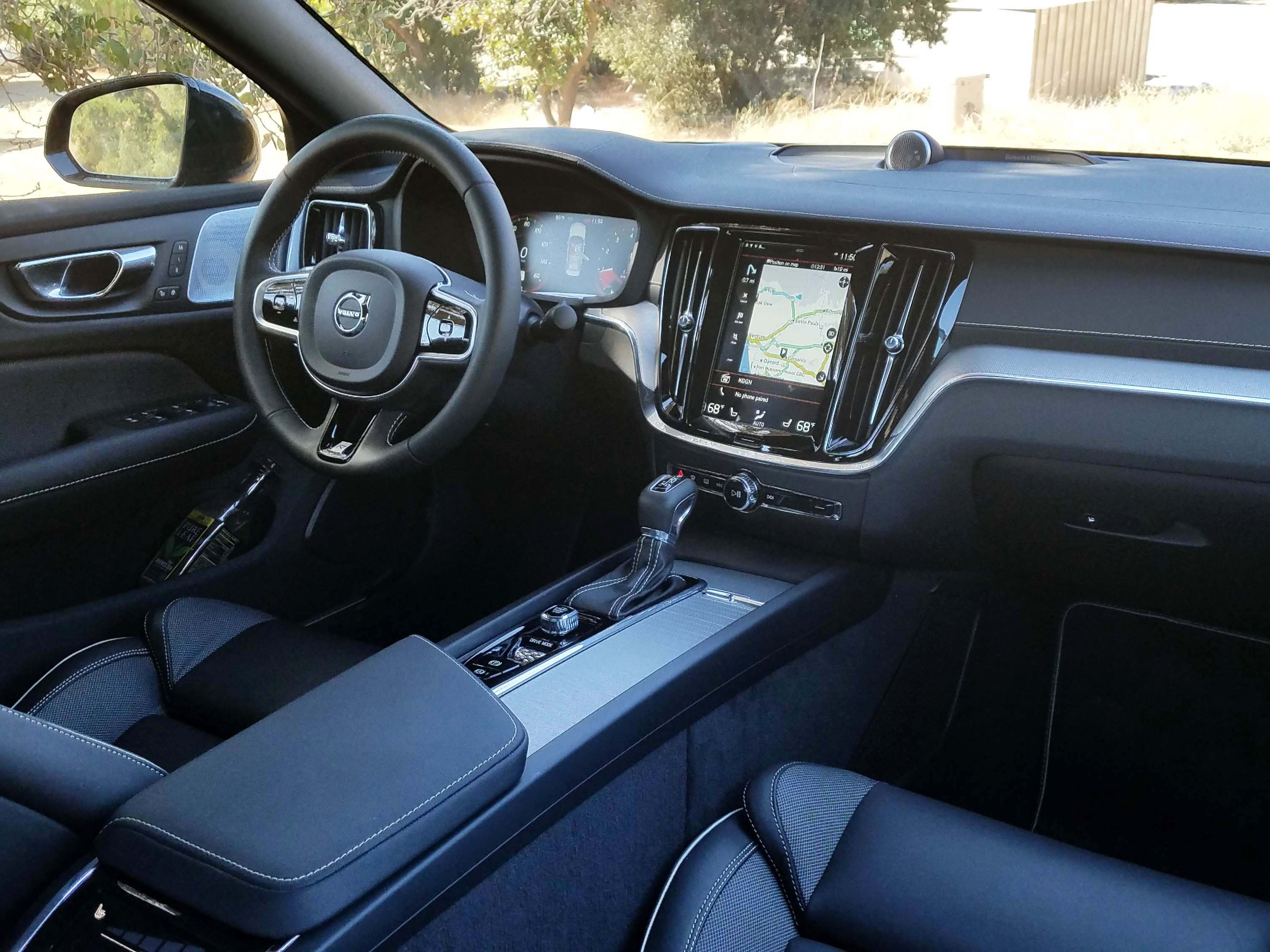 The interior of the 2019 Volvo S60 features comfy seats, a standard panoramic sunroof and unique console controls like a twist, rectangular starter button.
