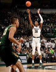 Michigan State freshman Marcus Bingham scored 12 points in an exhibition game Tuesday against Northern Michigan.