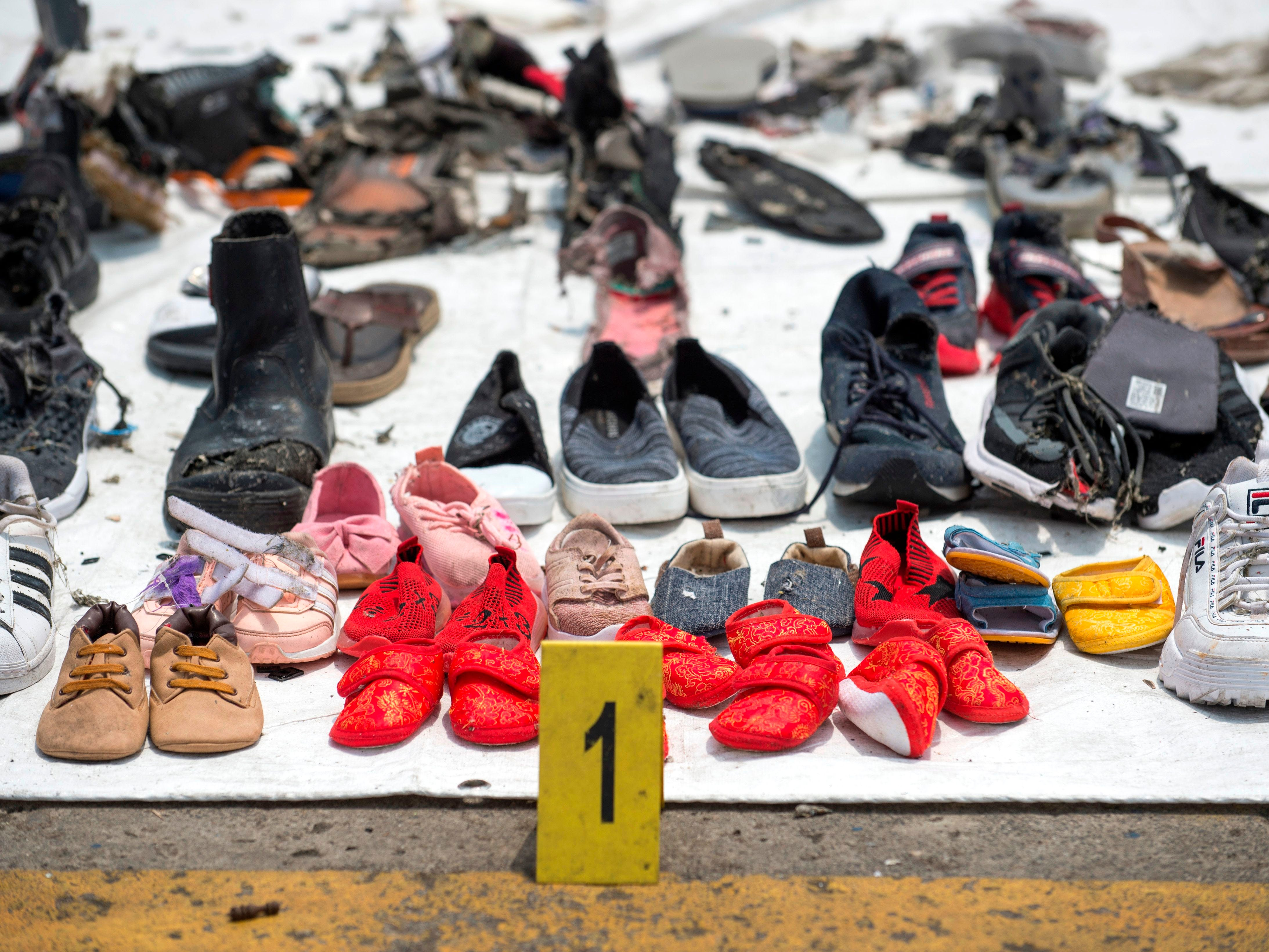 Shoes found during the search for victims of the ill-fated Lion Air flight JT 610 are collected at the Jakarta International Container Terminal in Jakarta, on Oct. 31, 2018. Boeing officials were set to meet with Lion Air after Indonesia orders an inspection of the U.S. plane maker's 737-MAX jets in the wake of the deadly crash feared to have killed 189 people.