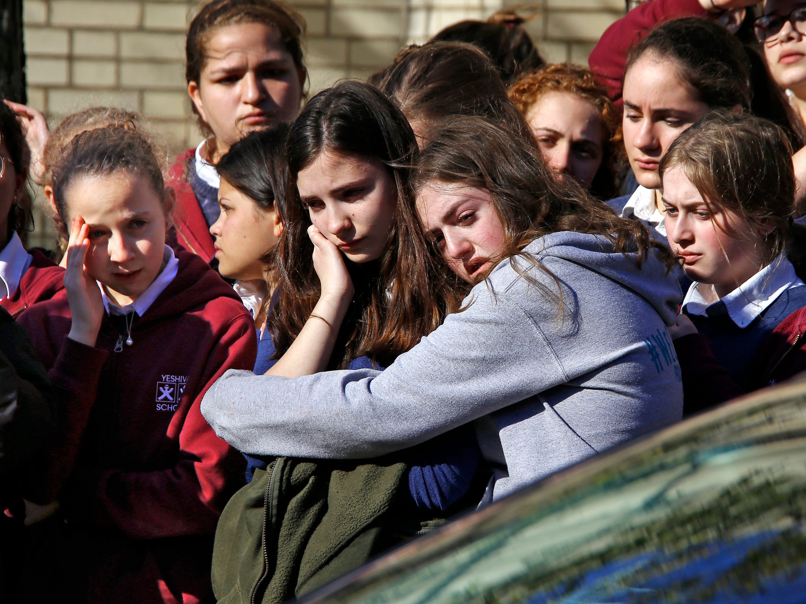 Students from the Yeshiva School in the Squirrel Hill neighborhood of Pittsburgh stand outside the Beth Shalom Synagogue after attending the funeral for Joyce Fienberg, Wednesday, Oct. 31, 2018. Fienberg, 75, Melvin Wax, 87, and Irving Younger, 69, were to be laid to rest as part of a week-long series of services for the 11 people killed in Saturday's shooting rampage at the Tree of Life synagogue.