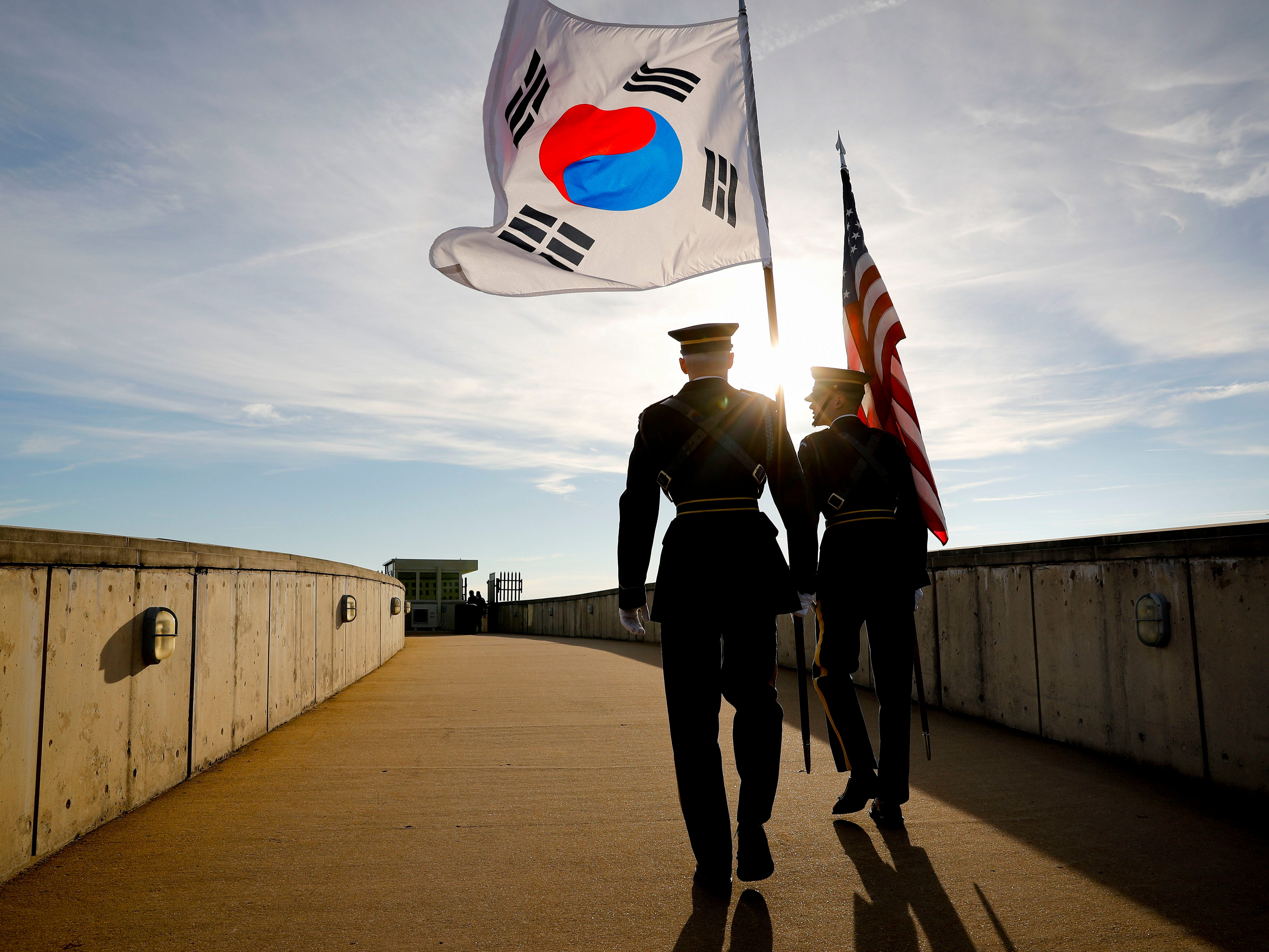 Members of the Honor Guard carry U.S. and South Korea flags after participating in the 2018 Security Consultative at the Pentagon, co-hosted by Defense Secretary Jim Mattis and South Korea Minister of Defense Jeong Kyeong-doo, Wednesday, Oct. 31, 2018.