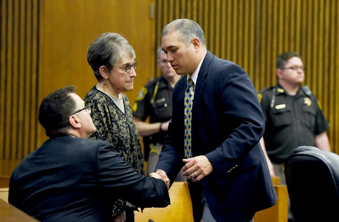 Mark Bessner, right, thanks his attorneys, Richard Convertino and Lenore Ferber, after the mistrial was declared Wednesday