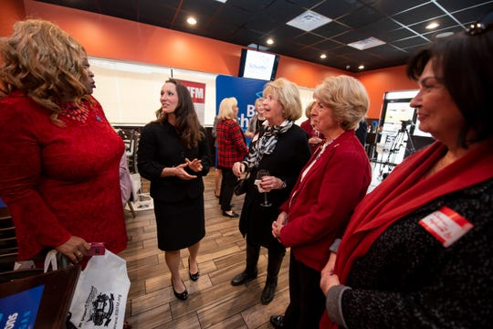 Linda Lee Tarver, at left, and Lisa Posthumus Lyons, second from left, the GOP candidate for lieutenant governor, chat before the start a campaign event hosted by the Republican Women's Federation of Michigan at the Taproom in Royal Oak on Tuesday.