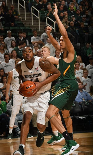 Nick Ward drives the baseline with his eyes on the basket.
