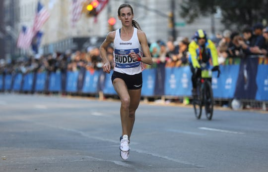 Elmira native Molly Huddle finished third in her marathon debut at the 2016 New York City Marathon.