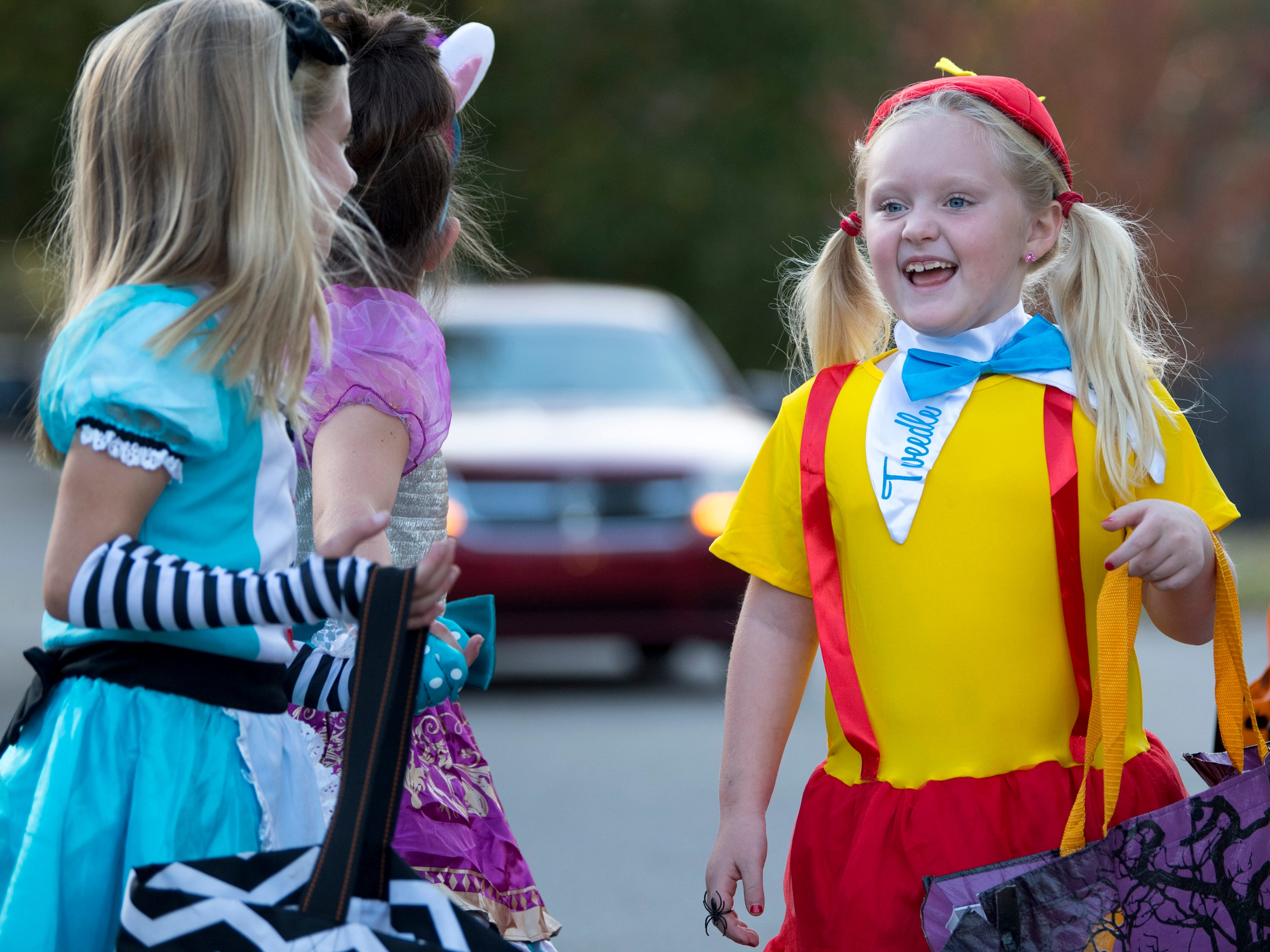 Alice in Wonderland was represented by, from left, Rhaelen Krantz, 8, Presley Kleeman, 7, Sabrynna O'Daniel, 8, and Charley Lynch, 7, (not pictured) in a Newburgh, Ind., neighborhood Tuesday evening.