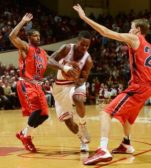 Indiana guard Kevin Yogi Ferrell drives the lane around Southern Indiana guard Lawrence Thomas (12) during an exhibition at Assembly Hall, Oct. 26, 2013.