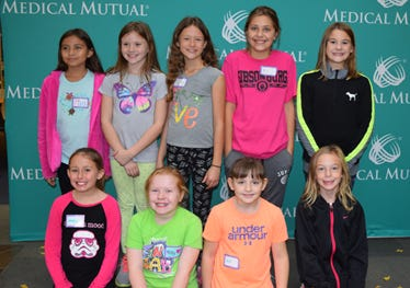"""Gibsonburg Girl Scouts help to create a curriculum for """"Staying Fit""""."""