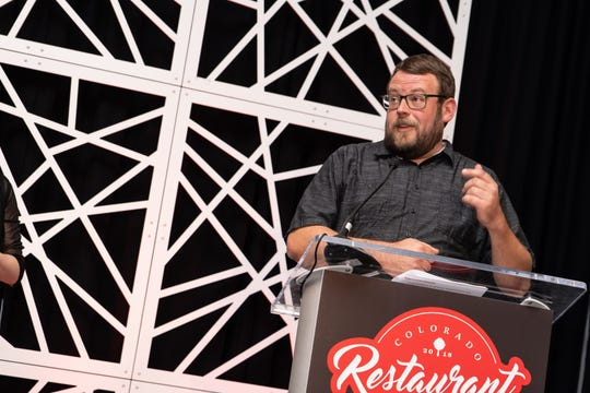 Brian Seifried accepts an award from the Colorado Restaurant Association.