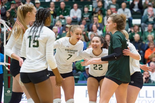 CSU celebrates a point against Wyoming during a game at Moby Arena on October 30, 2018.