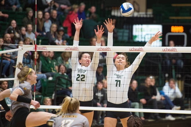 CSU's Katie Oleksak and Paulina Hougaard-Jensen jump high in an attempt to block the ball in this file photo. The Rams had 16.5 blocks in a sweep of Cal Poly on Thursday night.