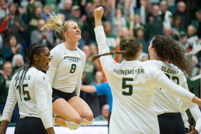 CSU volleyball player Amanda Young celebrates her team's 3-1 win over rival Wyoming on Tuesday at Moby Arena.