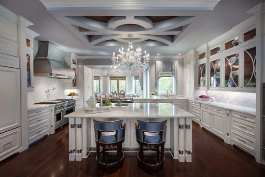 The biggest change, and the one that is award winning, is the kitchen. It won a first-place national award for best kitchen design in Florida from Wood-Mode Fine Custom Cabinetry.