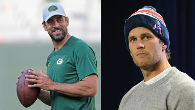 Aaron Rodgers, left, and Tom Brady